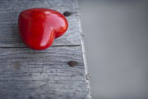 red heart on wood table