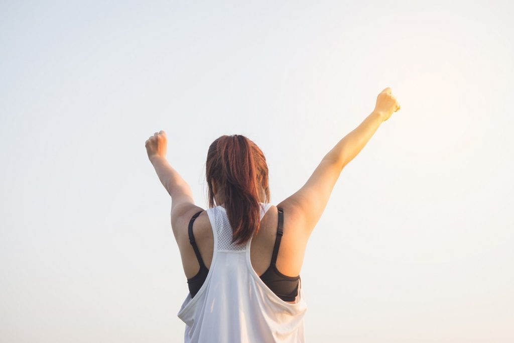 fitness woman raising arms